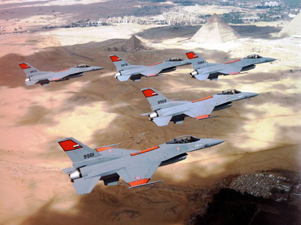 A five-ship formation of Egyptian AF F-16C Block 40s over the pyramids. These aircraft were delivered from 1994 to 1995 under the Peace Vector IV program. In July 2015, the U.S. announced further deliveries of F-16s to Egypt. (Egyptian AF photo)
