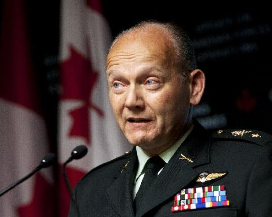 Canadian Forces spokesperson Brigadier-General Richard Blanchette speaks during a news conference at the Department of National Defense headquarters in Ottawa, Canada, on April 6, 2011. (Xinhua / Christopher Pike)