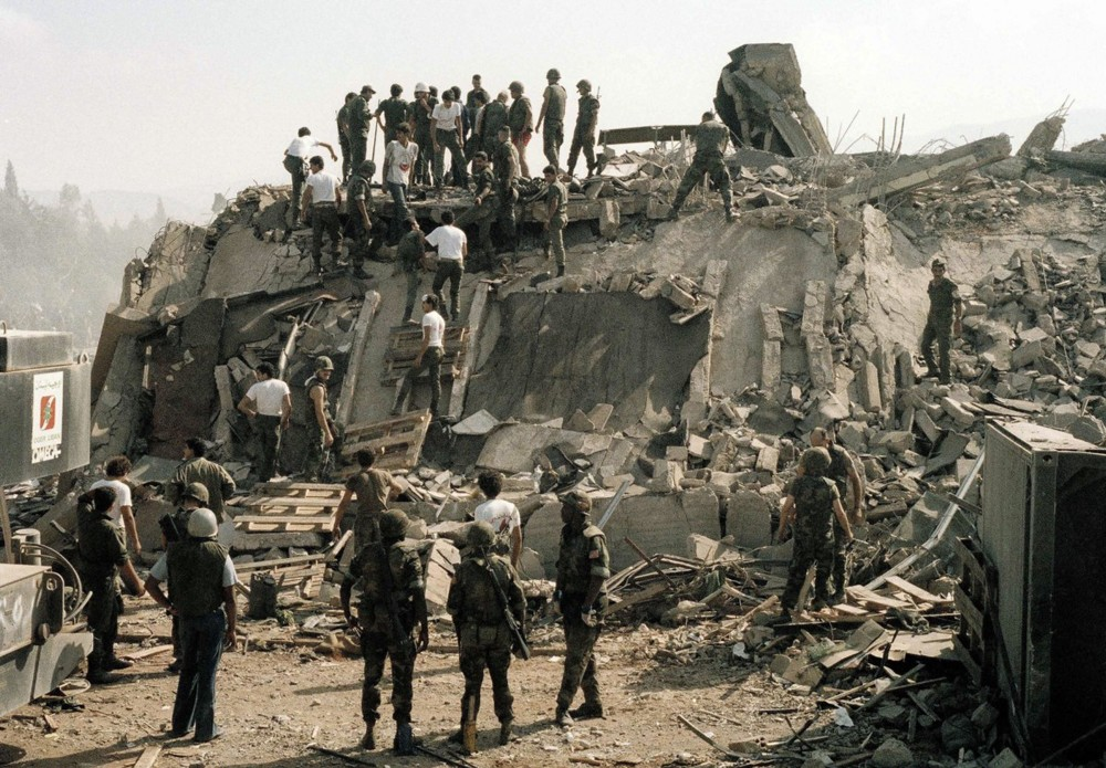 Rescue workers remove the body of a U.S. Marine from the rubble of the Marine Battalion headquarters at the Beirut International Airport on Oct. 23, 1983 (AP)