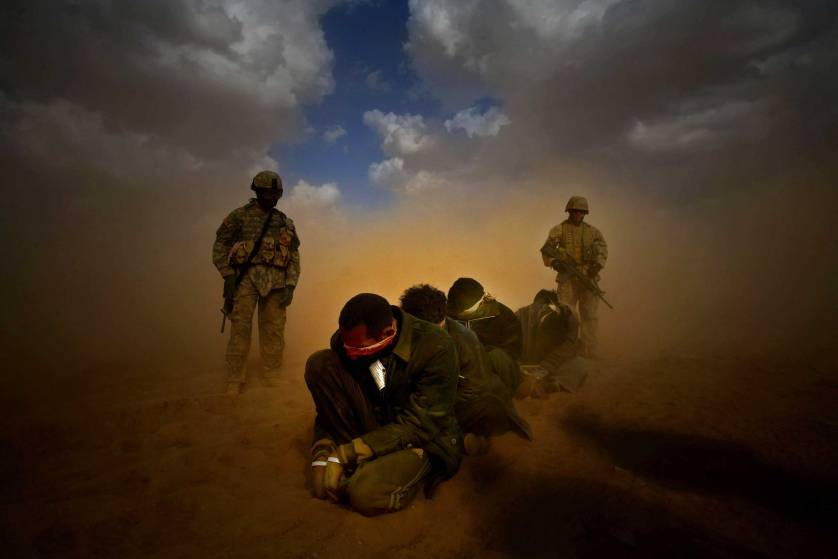 Marines organize transfer of detainees as a part of Operation Steel Curtain in 2005. (Jehad Nga/Corbis)