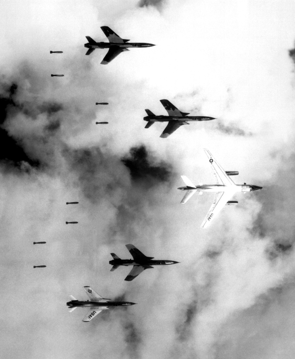 Flying under radar control with a B-66 Destroyer, Air Force F-105 Thunderchief pilots bomb a military target through low clouds over the southern panhandle of North Viet Nam. June 14, 1966. (Cecil J. Poss, Wikimedia Commons)