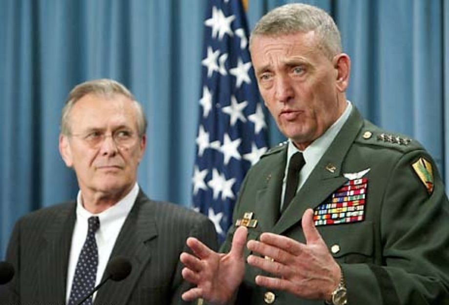 General Tommy Franks, commander of the U.S. Central Command, right, gestures during a news conference as Secretary of Defense Donald Rumsfeld looks on at the Pentagon in Washington Friday, May 9, 2003. Rumsfeld said it is not possible to know how long U.S. forces will have to remain in Iraq and suggested that stabilizing the newly liberated country could take longer than a year. (AP Photo, Charles Dharapak)