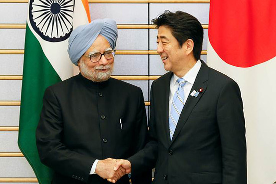 Manmohan Singh, India's prime minister, left, shakes hands with Shinzo Abe, Japan's prime minister, during a meeting in Tokyo, in May 2013.