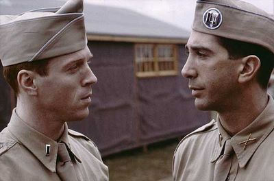Richard Winters (Damian Lewis) and Herbert Sobel (David Schwimmer) in Band of Brothers (2001).