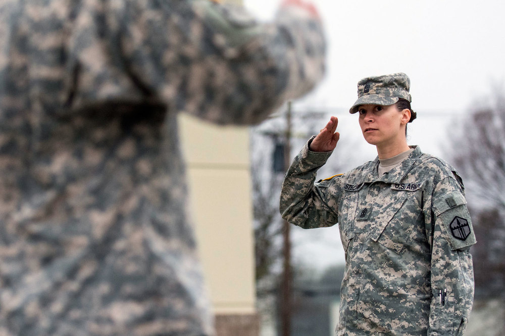 First Sgt. Raquel Steckman salutes her platoon sergeants with the 374th Engineer Company (Sapper), headquartered in Concord, Calif., during formation. (U.S. Army Photo)