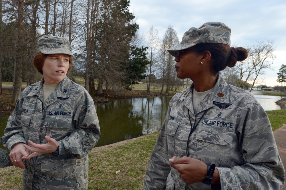 U.S. Air Forces Central Command deputy command surgeon (left), walks with AFCENT chief of clinical operations, during a mentoring session. (U.S. Air Force photo, A1C Jonathan Bass)