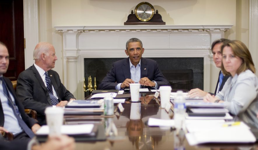 President Barack Obama and Vice President Joe Biden, left, meet with members of the National Security Council, Monday, Aug. 18, 2014, in the Roosevelt Room of the White House in Washington. Also at the meeting, from left are, Deputy National Security Adviser Ben Rhodes, Biden, Obama, Deputy National Security Adviser Tony Blinken, and Homeland Security Adviser Lisa Monaco. (AP Photo/Pablo Martinez Monsivais)