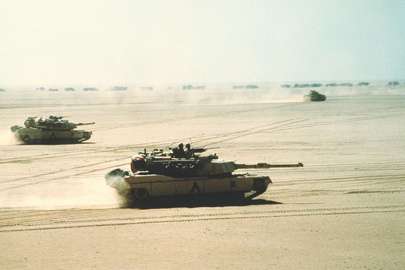 M1A1 Abrams tanks race across the desert on their way to engage the Iraqis. (U.S. Department of Defense photo)