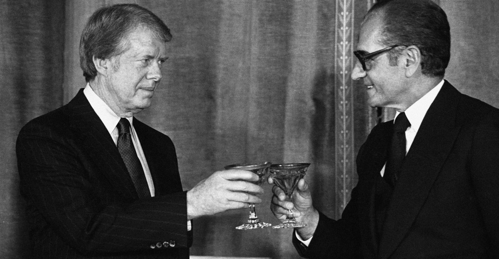 President Jimmy Carter and the Shah of Iran Reza Pahlavi toasting in Tehran | Photo courtesy History.com