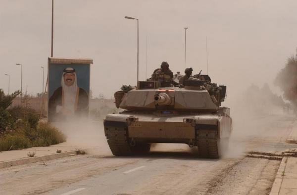An Abrams tank from the 3rd Infantry Division races towards Baghdad during the 2003 invasion.