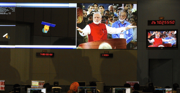 Indian Space Research Organization scientists and engineers watch Prime Minister Narendra Modi (L) on screens after India's Mars orbiter was successfully put around the Red Planet's orbit, at their Spacecraft Control Center in the southern Indian city of Bangalore. (Reuters)