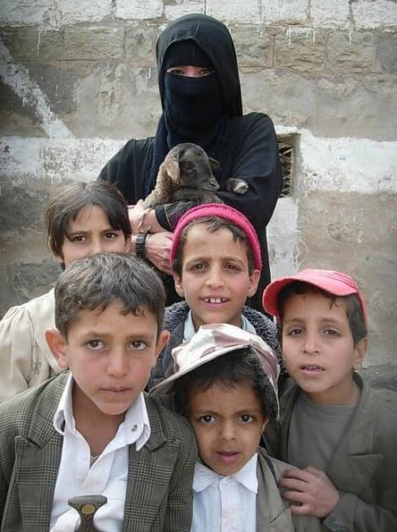 Yemeni kids; note boy on left is wearing a ceremonial knife. ( Yemen at the Crossroads )