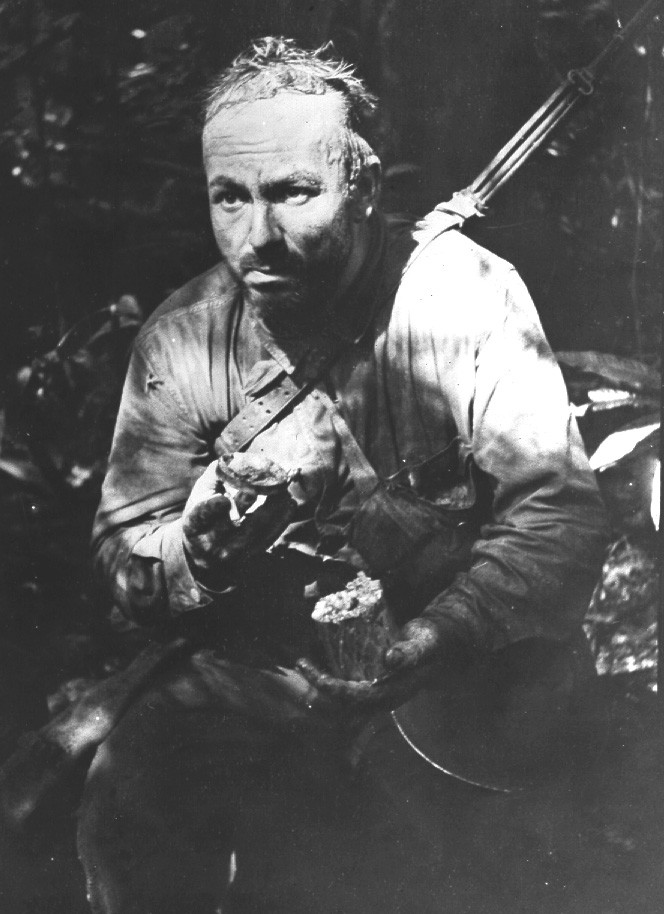 U.S. Army Private Lloyd Culuck of A Company, 1st Battalion, 172nd Infantry, July, 1943. The hollow-eyed look, rotting clothes, and attitude of paranoia mixed with exhaustion was a common site on New Georgia. (Source: National Archives)