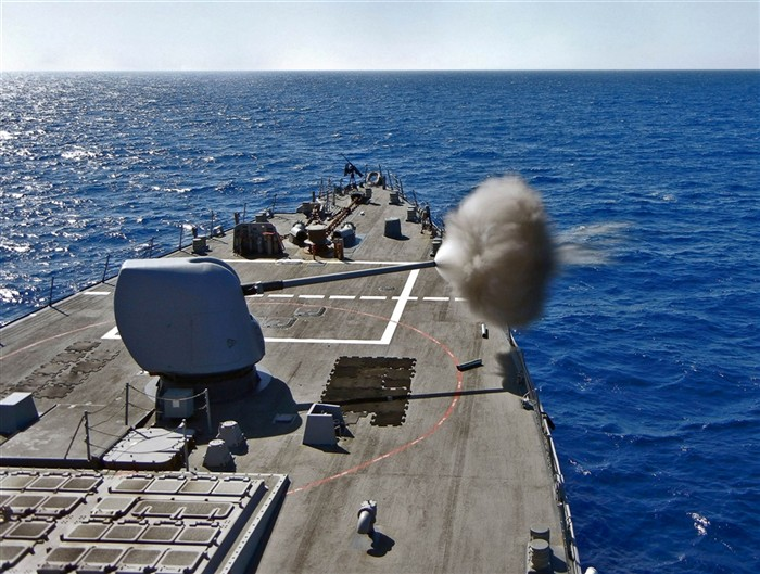 The U.S.S. Barry fires its MK-45 5-inch 54mm cannon during an exercise | U.S. Navy