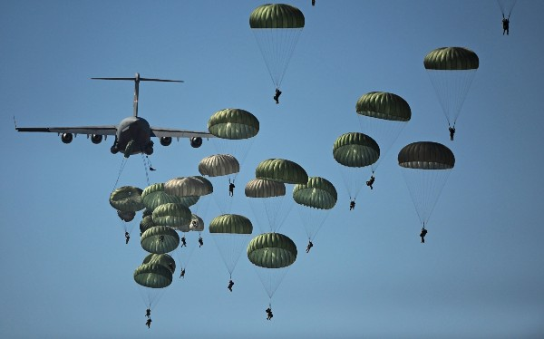 U.S. Army paratroopers from the 82nd Airborne Division descend to the ground after jumping out of a C-17 Globemaster III aircraft over drop zone Sicily during Joint Operations Access Exercise at Ft. Bragg, N.C. (Photo by A1C James Richardson, USAF)