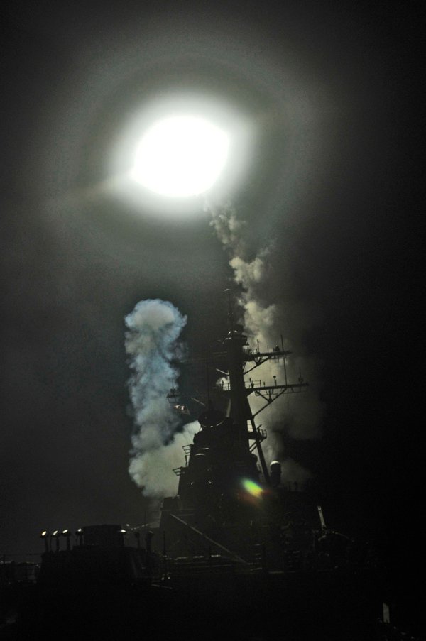 The Arleigh Burke-class guided-missile destroyer USS Barry (DDG 52) launches a Tomahawk missile in support of Operation Odyssey Dawn on March 19, 2011. (Wikimedia Commons)