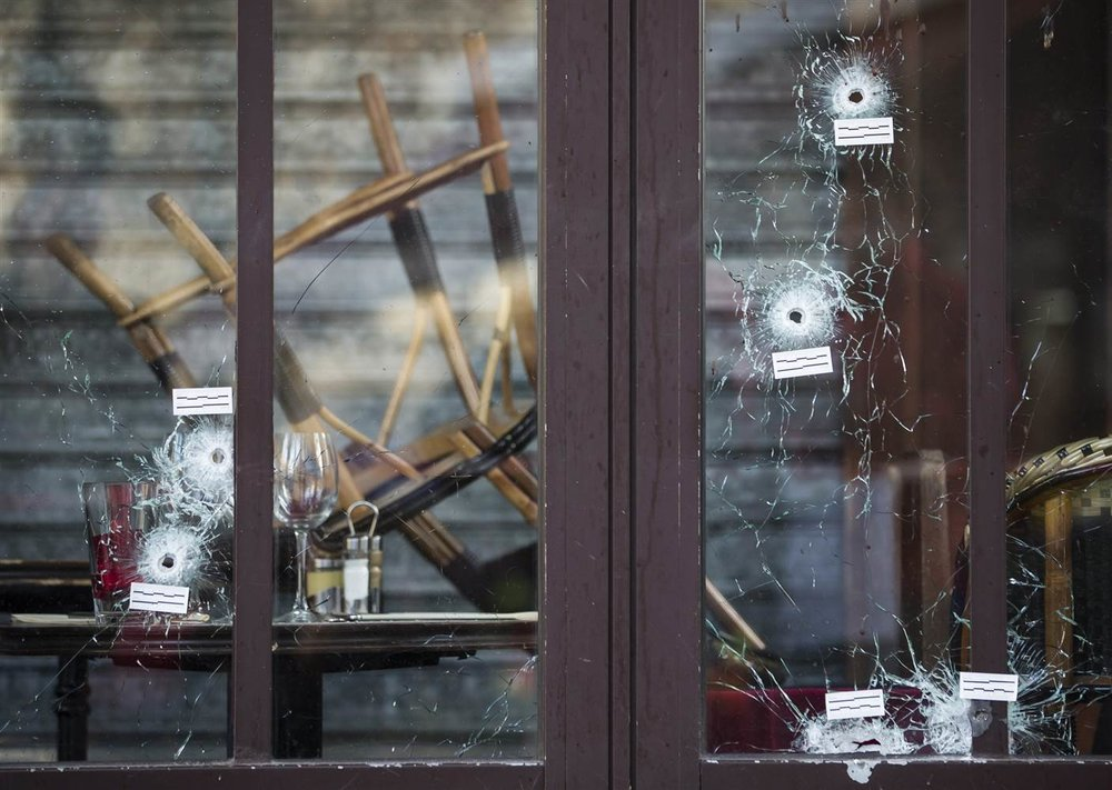 Bullet holes in the terrace windows of Cafe Bonne Biere in Paris, France, 15 Nov 2015. (Ian Langsdon | EPA)