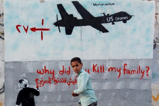 A Yemeni boy in Sanaa walks past a mural depicting a U.S. drone. (Mohammed Huwais | AFP | Getty Images)