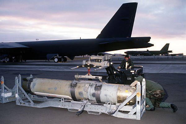 Airmen prepare to load a Mark 60 CAPTOR (encapsulated torpedo) anti-submarine mine onto a B-52G Stratofortress. (U.S. Navy)