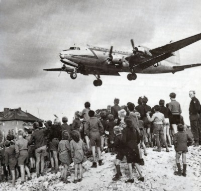 Berliners watching a C-54 land at Berlin Tempelhof Airport, 1948. (Wikimedia Commons)