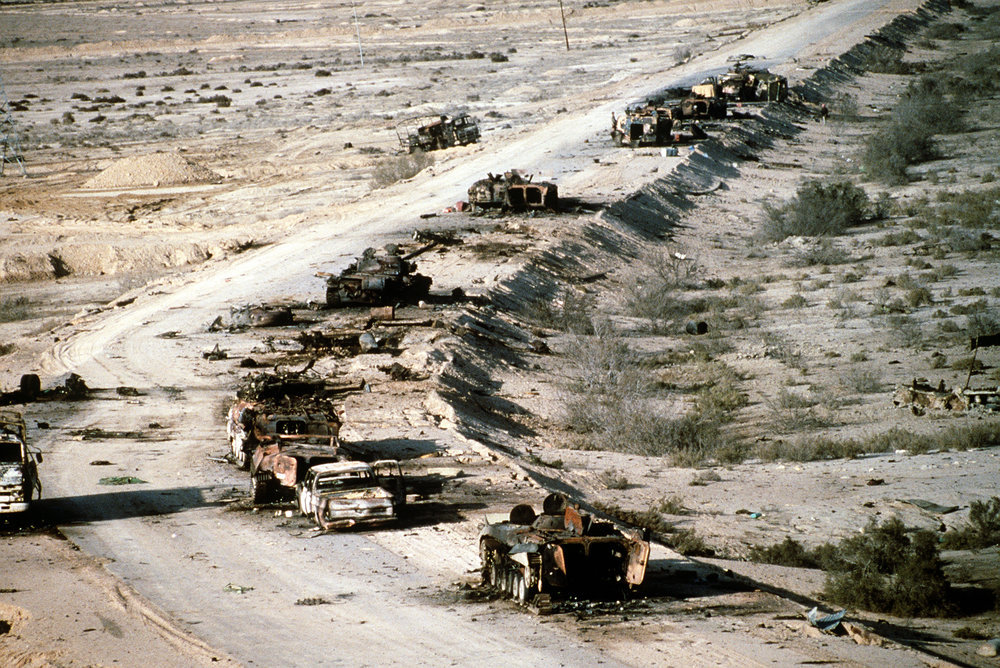 A view of Iraqi armored personnel carriers, tanks and trucks destroyed in a Coalition attack along a road in the Euphrates River Valley during Operation Desert Storm, 4 March 1991. (Wagner/DOD Photo)