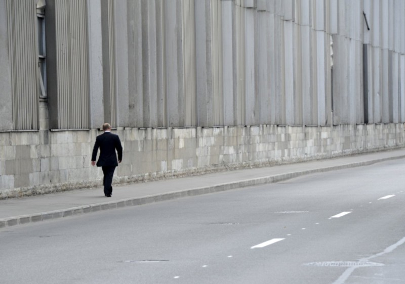 Putin walking alone after the funeral of his Judo Coach