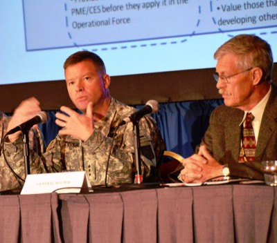 Lieutenant General David G. Perkins (left), commander, Combined Arms Center, Fort Leavenworth, Kan., and retired Lt. Gen. Don Holder, a military consultant, discuss the role of leadership and education in mission command during the Mission Command Symposium in Kansas City, Mo., Jun 18.