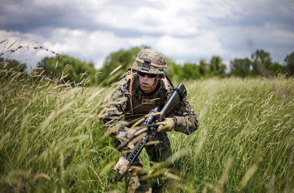 Cpl. William Schuler, with Black Sea Rotational Force 13, moves to his ambush position during a live-fire ambush exercise in Balta Verde Training Area, Craiova, Romania, March 14, 2013. (USMC photo by 1st Lt. Hector R. Alejandro Jr.)