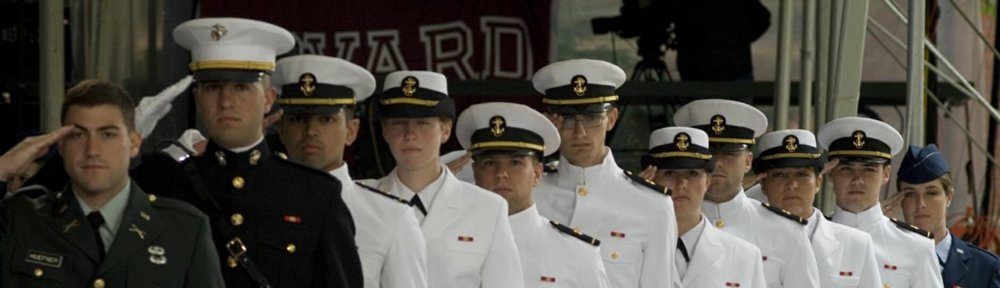 Graduating ROTC students. From left to right, Army Second Lieutenant Robert Huefner, Navy Second Lieutenant John Cancian (USMC), Ensigns Donald M. Coates, Erika E. Helbling, Patrick Morrissey, Erik Sand, Meredith Ellen Sandberg, Jonathan Sieg, Danielle Thiriot and Aaron Woodside, and Air Force Second Lieutenant Lauren L. Brown.