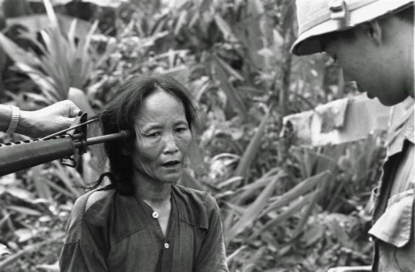 A female Viet Cong suspect is questioned at gunpoint by a South Vietnamese national police officer at Tam Ky, about 350 miles north of Saigon, November 1967. The M-16 rifle was held by a U.S. soldier during an operation of the 101st Airborne Brigade, searching villages of the coastal plains for suspected Viet Cong enclaves. (Via AP/NBCNews)