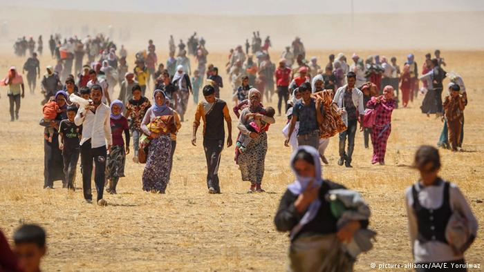 Thousands of Yezidis trapped in the Sinjar mountains as they fled from Islamic State are rescued by Kurdish forces. (E. Yorulmaz/Getty Images)