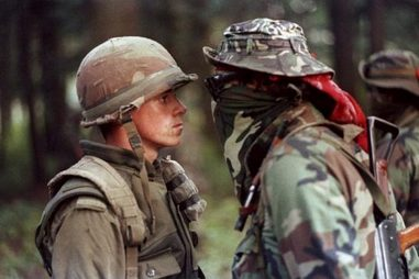 "Famous stand-off during the Oka Crisis between Pte. Patrick Cloutier, a 'Van Doo' perimeter sentry, and Anishinaabe warrior Brad ""Freddy Krueger"" Larocque (Wikimedia)"