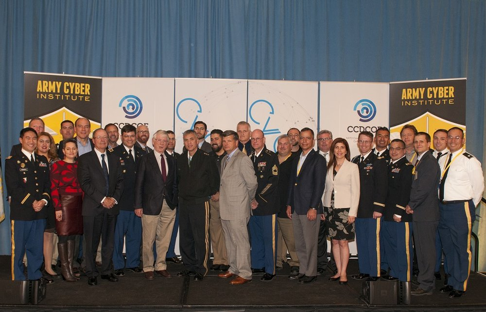 Army Cyber Institute members with LTG Paul Nakasone, GEN (R) Keith Alexander, Mr. Ted Koppel, Mr. Ronal Pontius at CyCon U.S. on Saturday, 22 October, 2016. (Army Cyber Institute at West Point)