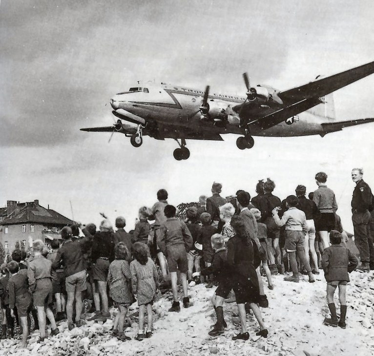Berliners watch a Douglas C-54 Skymaster land at Tempelhof Airport, 1948 (Wikimedia Commons)