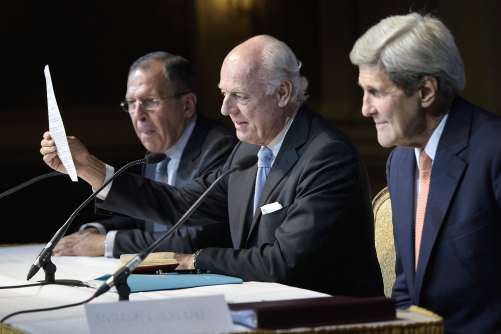 Russian Foreign Minister Sergei Lavrov, left, and, Secretary of State John Kerry, right, listen as UN Special Envoy for Syria Staffan de Mistura speaks during a news conference in Vienna, Austria, October 30, 2015. (Photo: AP/Brendan Smialowski)