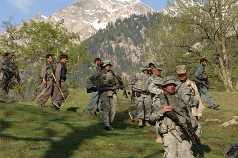 U.S. and Afghan troops on patrol in Nuristan. (Long War Journal)