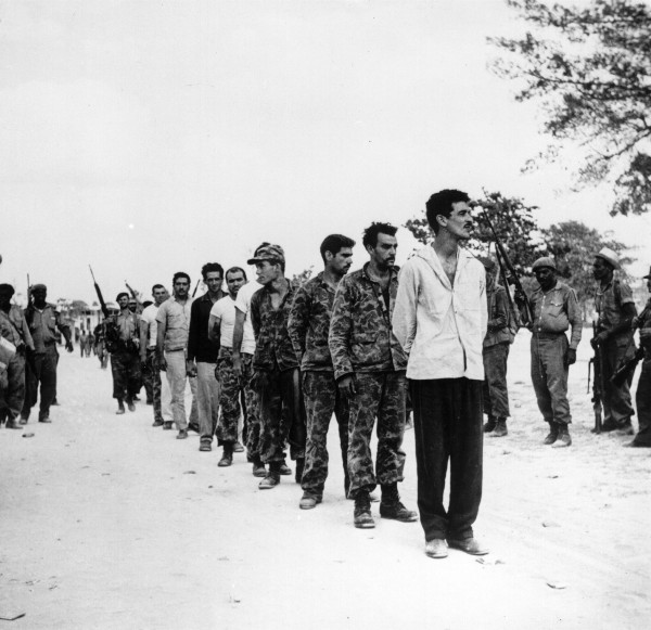 A group of captured U.S.-backed Cuban exiles, known as Brigade 2506, being lined up by Fidel Castro's soldiers at the Bahía de Cochinos (Bay of Pigs), Cuba, following an unsuccessful invasion of the island, April 1961. (Hulton Archive/Getty Images)
