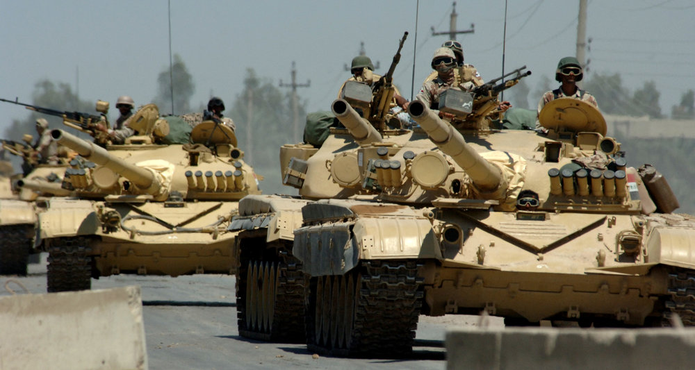 Iraqi tanks assigned to the Iraqi Army 9th Mechanized Division drive through a checkpoint near Forward Operating Base Camp Taji, Iraq. (Michael Larson/U.S. Navy Photo)