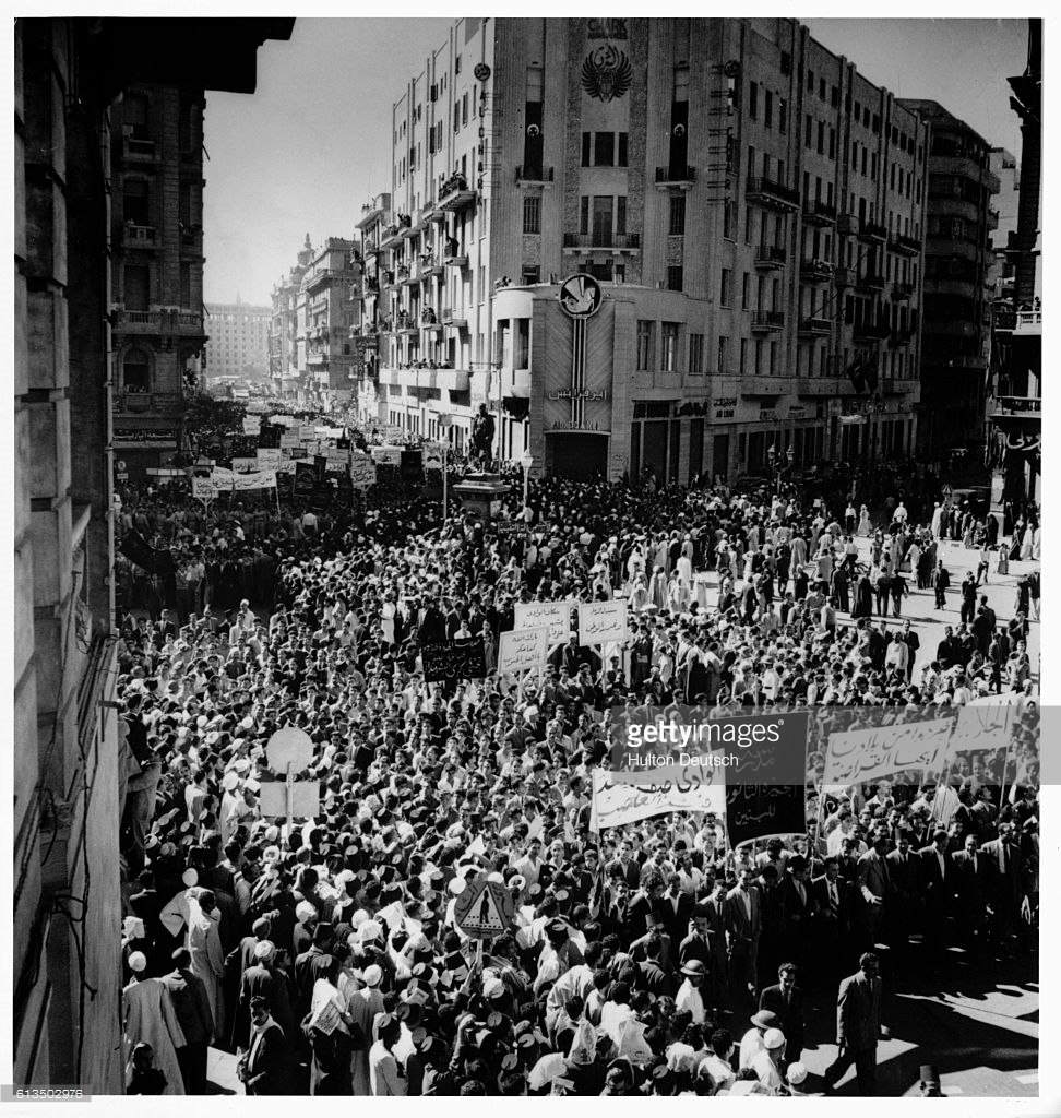 Egyptians crowd the streets of Cairo to protest the British and French invasion of the Suez Canal area during the Suez Crisis of 1956 | Getty Images