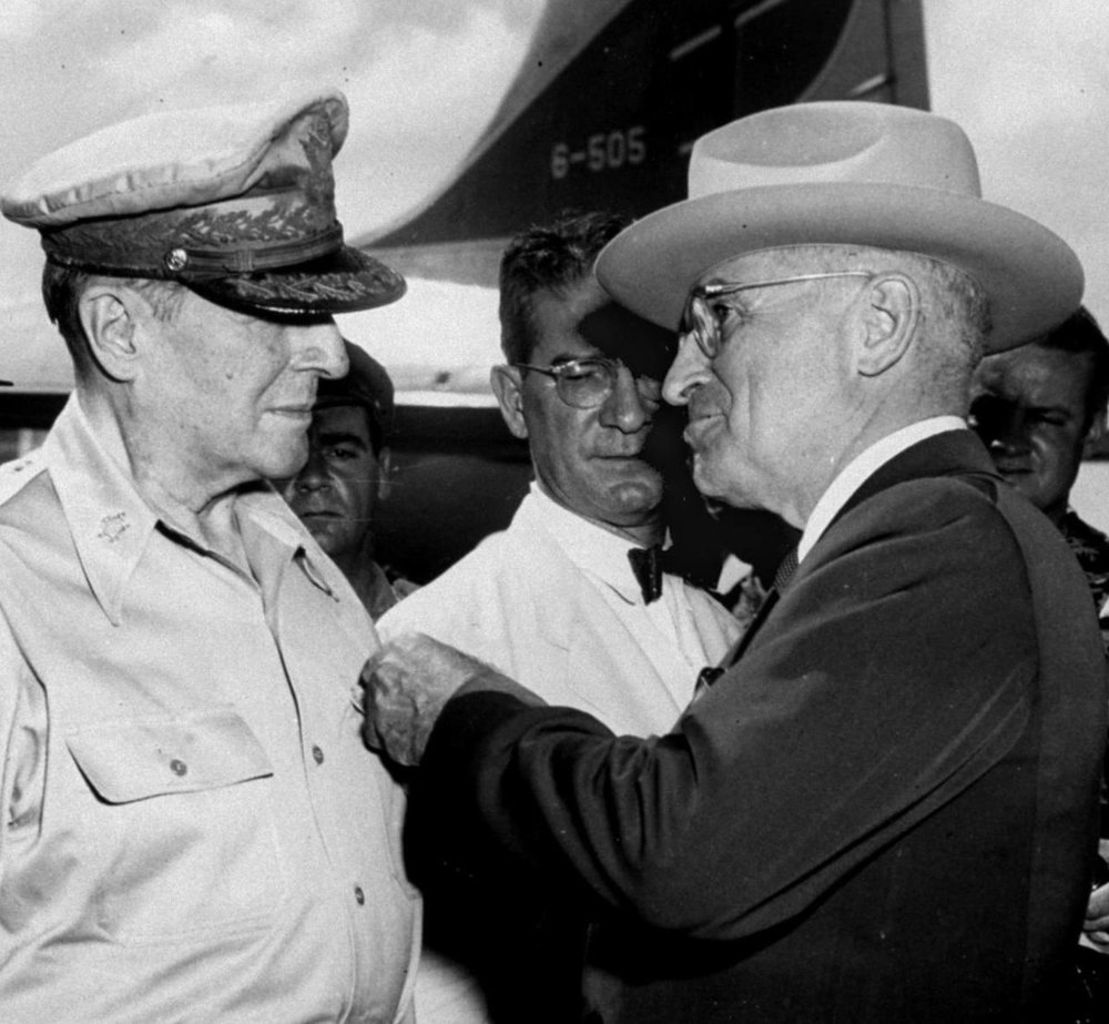 President Truman pins the Distinguished Service Medal on the shirt of Gen. Douglas MacArthur in this Oct. 14, 1950 | AP
