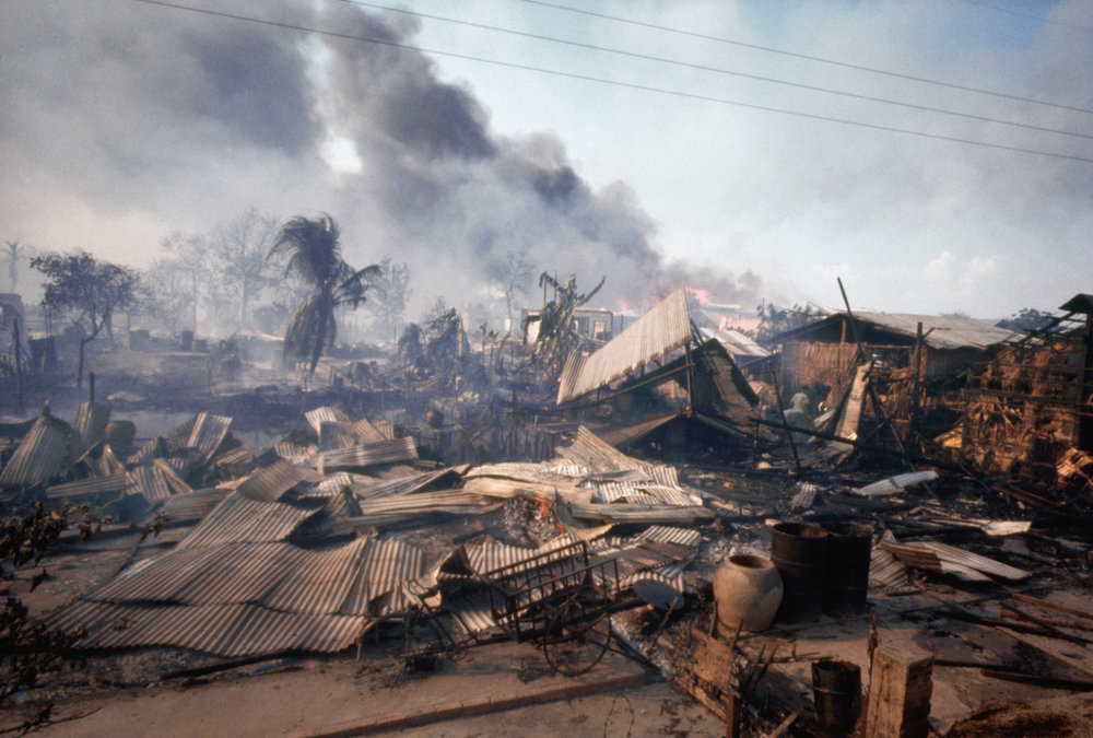 A market in the Cholon District of Saigon is covered in smoke and debris after the Tet Offensive. (History.com)