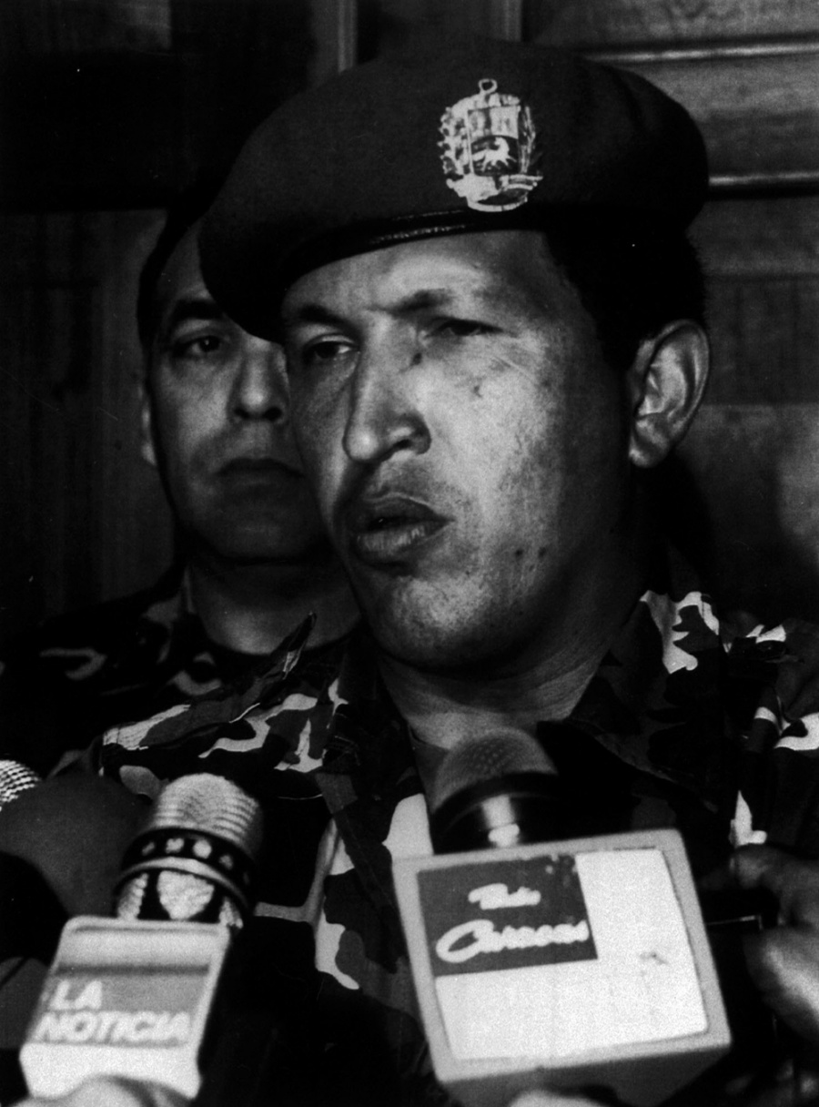"Hugo Chávez telling comrades to lay down their arms and that the movement's objectives had not been achieved ""for now,"" ending his 1992 coup attempt. (Venezuela Analysis/AP)"