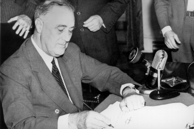 President Roosevelt signs the Selective Service Training and Service Act on Sept. 16, 1940, establishing the first peacetime draft and creating the Selective Service System. (U.S. Government Photo/Wikimedia)