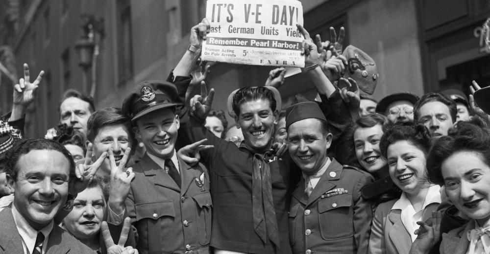 A crowd gathers in Times Square to celebrate victory over Germany in World War II. (Corbis/WWII National Museum)