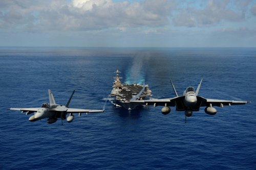 Two F/A-18E Super Hornets take off from the USS John C. Stennis aircraft carrier | Mass Communication Specialist Seaman Apprentice Ignacio D. Perez, US Navy