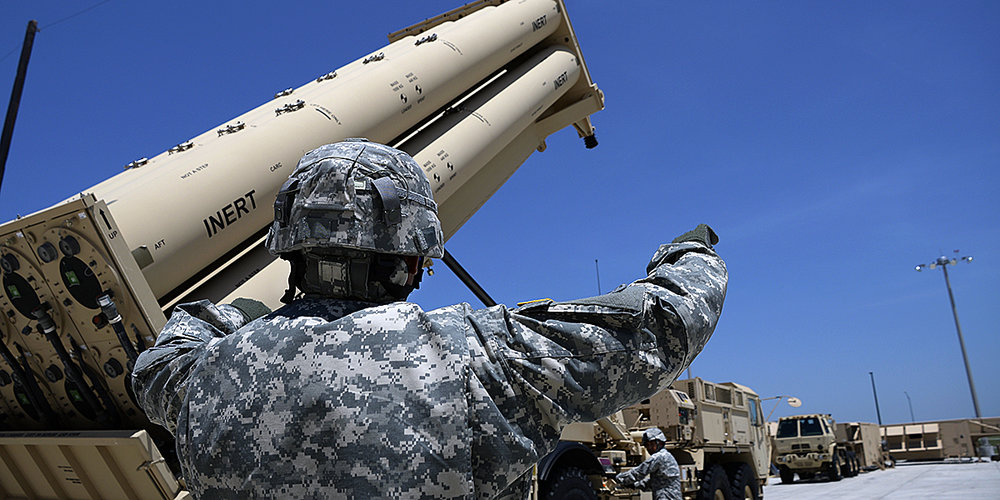 Sgt. 1st Class Benson Gatchalian raises the launcher of a THAAD unit outside the THAAD Instructional Facility as Sgt. 1st Class Penieli Vaisagote monitors | Clifford Kyle Jones