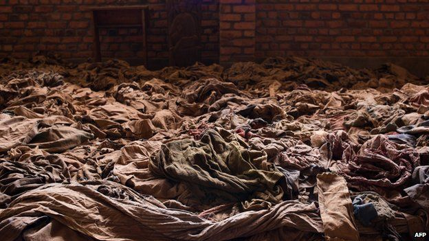 Clothes of people killed in the Nyamata Church in Kigali, Rwanda, which has been turned into a memorial. Approximately 10,000 Rwandans seeking refuge from the genocide were killed there in April 1994, and some 50,000 victims of the genocide are buried there. (AFP/CNN)