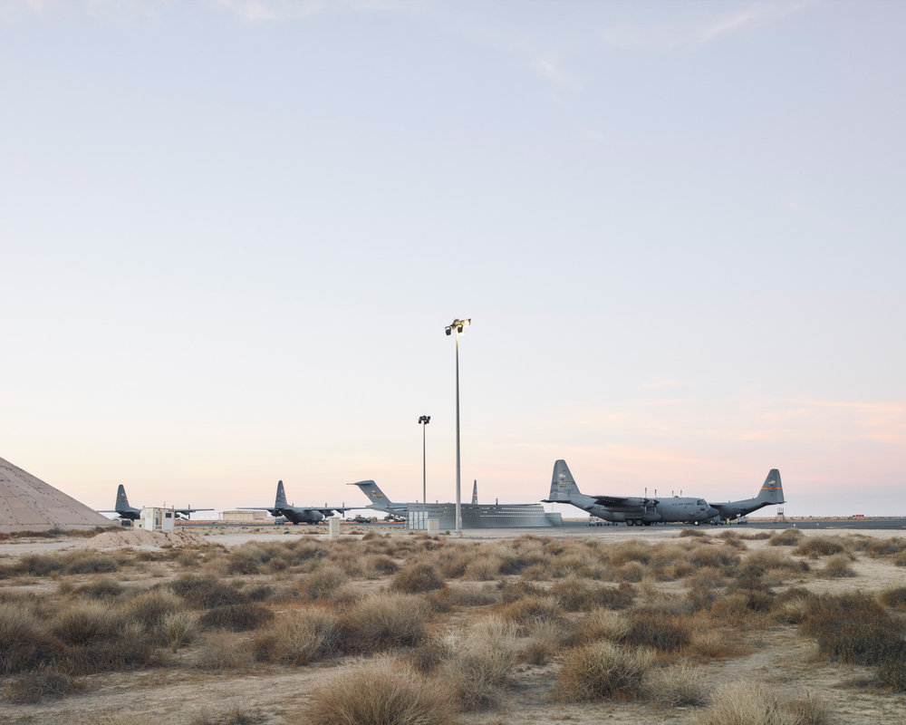 C-17s and C-130s line up on the ramp. (Jason Koxvold)