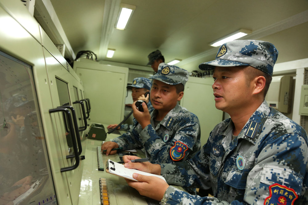 Command and control technicians assigned a missile brigade of the air force under the PLA Central Theater Command deal with flight information during a ground-aerial confrontation drill at a military training base in China's northern Fujian province on Oct. 10, 2016. (81.cn/ Li Ming)