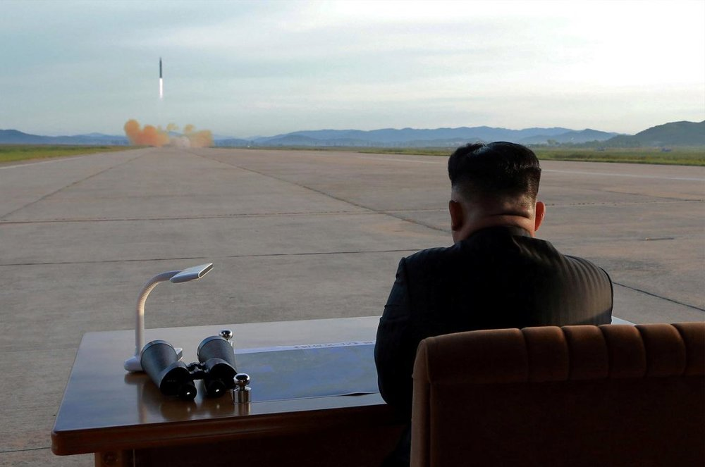 North Korean leader Kim Jong Un watches the launch of a Hwasong-12 missile in this undated photo released by North Korea's Korean Central News Agency (KCNA) on September 16, 2017. (KCNA/Reuters)